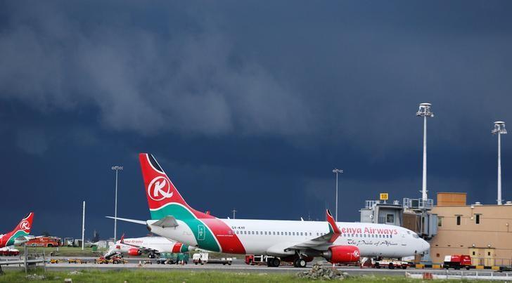 Kenya Airways planes are seen parked at the Jomo Kenyatta International airport near Kenya's capital Nairobi, April 28, 2016. Picture taken April 28, 2016. REUTERS/Thomas Mukoya/File Photo
