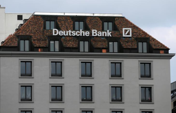 A logo is pictured on the Deutsche Bank building in Geneva, Switzerland, October 11, 2016.  REUTERS/Denis Balibouse