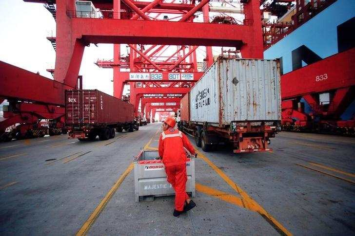 A worker is seen at the Yangshan Deep Water Port, part of the Shanghai Free Trade Zone, in Shanghai, China September 24, 2016. Picture taken September 24, 2016. REUTERS/Aly Song/File Photo