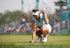 Golf - LPGA KEB Hana Bank Championship - Third Round - Incheon, South Korea - 15/10/16.  Alison Lee of U.S. studies a putt on the ninth green. REUTERS/Kim Hong-Ji