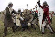 Re-enactors participate in a demonstration before a re-enactment of the the Battle of Hastings on the 950th anniversary of the battle, in Battle, Britain October 15, 2016.  REUTERS/Neil Hall