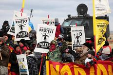 Dakota Access Pipeline protesters square off against police near the Standing Rock Reservation and the pipeline route outside the little town of Saint Anthony, North Dakota, U.S., October 5, 2016. REUTERS/Terray Sylvester/File Photo