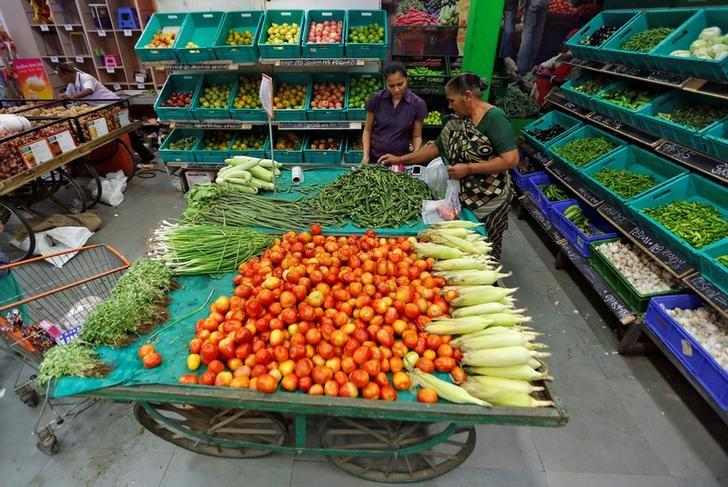 A woman buys vegetables at a food superstore in Ahmedabad, India October 13, 2016. REUTERS/Amit Dave