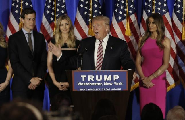 Republican U.S. presidential candidate Donald Trump speaks as his son-in-law Jared Kushner (L), daughter Ivanka (2nd from L) and his wife Melania (R) listen at a campaign event on the day that several states held presidential primary elections, including California, at the Trump National Golf Club Westchester in Briarcliff Manor, New York, U.S., June 7, 2016.  REUTERS/Mike Segar - RTSGHAS