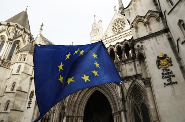 A European Union flag is waved outside the High Court in Central London, October 17, 2016. REUTERS/Stefan Wermuth