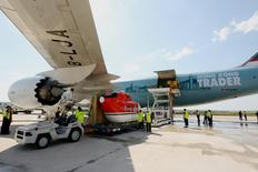 A Cathay Pacific Airways cargo plane is loaded with goods at Brisbane's West Wellcamp Airport November 23, 2015 in this handout provided by Cathay Pacific Airways October 19, 2016.     Cathay Pacific Airways/Andrew Coates/Handout via REUTERS