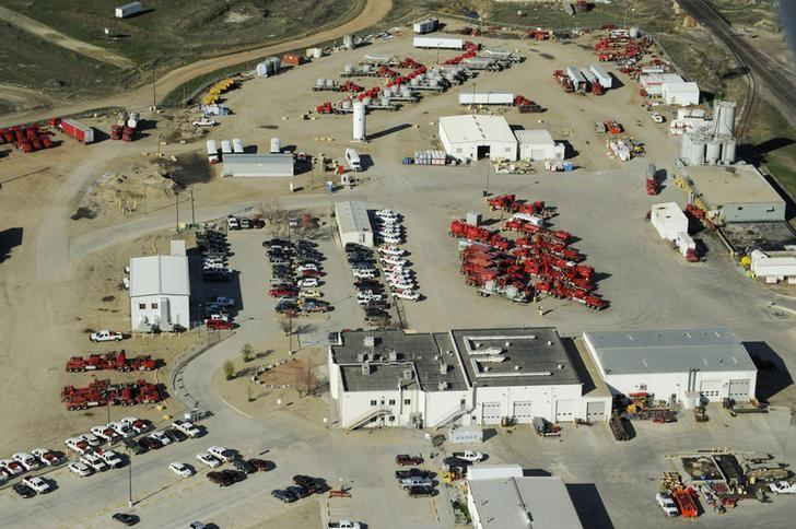Idle trucks and oil production equipment is seen in a Halliburton yard in Williston, North Dakota April 30, 2016. Picture taken April 30, 2016.  REUTERS/Andrew Cullen