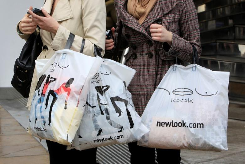 Women hold New Look shopping bags on Oxford Street in London, Britain, February 12, 2010. REUTERS/Suzanne Plunkett/File Photo