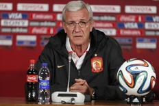 Marcello Lippi, coach of China's Guangzhou Evergrande, speaks during a news conference ahead of the Club World Cup, in Agadir December 16, 2013.  REUTERS/Youssef Boudlal