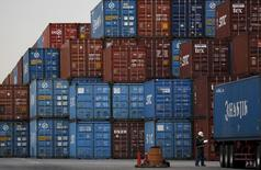 A laborer works in a container area at a port in Tokyo, Japan, March 16, 2016.  Japan's exports fell 4.0 percent in February from a year earlier, which was slower than a decline in the previous month, but economists worry that a renewed slowdown in emerging markets could curb future export growth.  REUTERS/Toru Hanai - RTSASTW