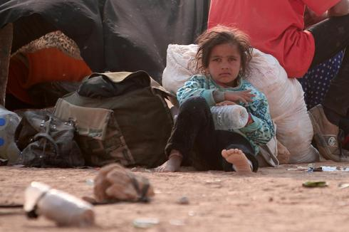 Fleeing one war-torn country for another