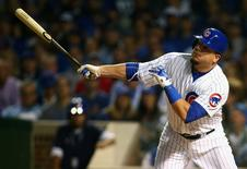 October 20, 2015; Chicago, IL, USA; Chicago Cubs left fielder Kyle Schwarber (12) hits a solo home run in the first inning against the New York Mets in game three of the NLCS at Wrigley Field. Mandatory Credit: Jerry Lai-USA TODAY Sports