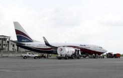 A Boeing 737-7BD Arik Air aeroplane is seen parked on the tarmac at the local airport in Lagos November 2, 2012. REUTERS/Akintunde Akinleye
