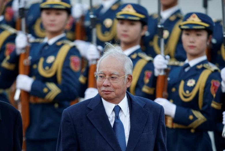 Malaysia's Prime Minister Najib Razak inspects honour guards during a welcoming ceremony at the Great Hall of the People, in Beijing, China, November 1, 2016. REUTERS/Jason Lee