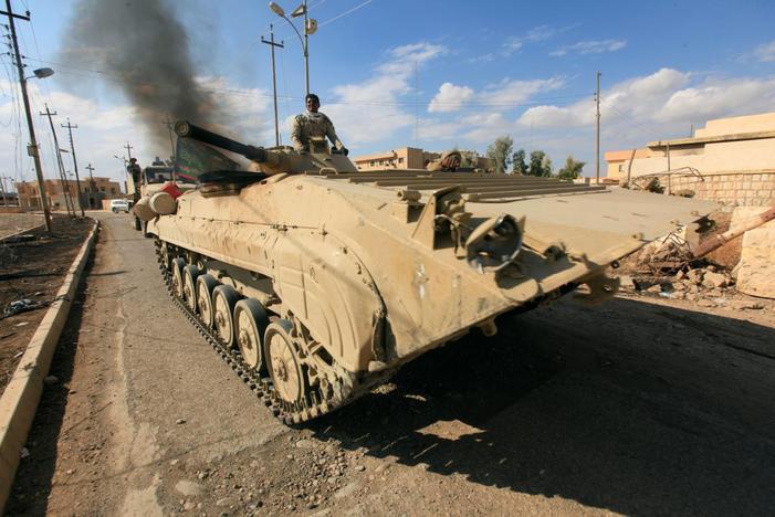 Military vehicles of Iraqi army take part in an operation against Islamic State militants in Qaraqosh, near Mosul, Iraq, November 2, 2016