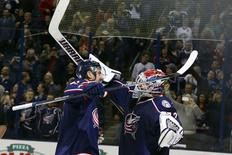 Nov 4, 2016; Columbus, OH, USA; Columbus Blue Jackets left wing Nick Foligno (71) and goalie Sergei Bobrovsky (72) celebrate after the game against the Montreal Canadiens during the third period at Nationwide Arena. Columbus shutout Montreal 10-0. Mandatory Credit: Russell LaBounty-USA TODAY Sports