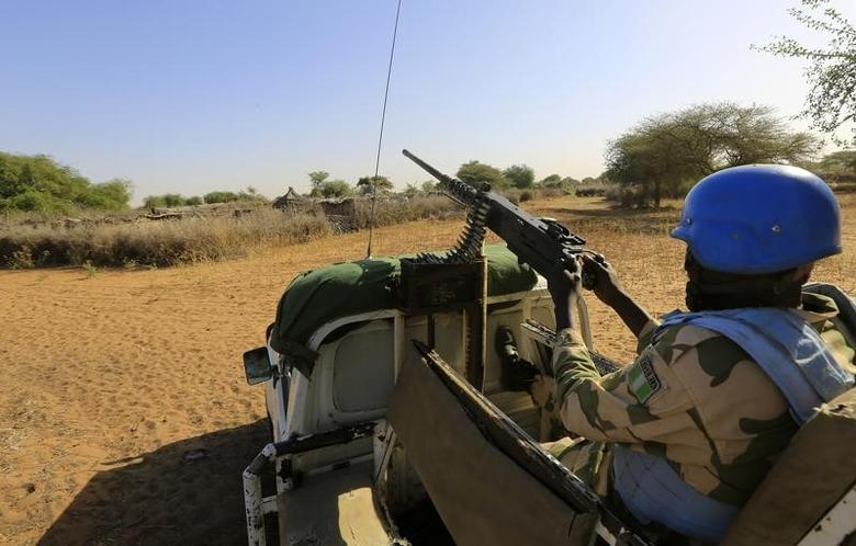 African Union - United Nations Hybrid Operation in Darfur (UNAMID) peacekeepers patrol the damaged and empty Labado village in South Darfur December 10, 2013. REUTERS/Mohamed Nureldin Abdallah