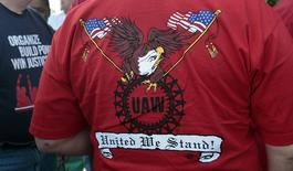 "A United Auto Workers union member wears a shirt with 'UAW United We Stand' on it during a ceremony where members of UAW Local 600 unfurled a banner to commemorate the 75th anniversary of the historic ""Battle of the OverPass"" in Dearborn, Michigan, U.S. May 25, 2012.  REUTERS/Rebecca Cook/File Photo"