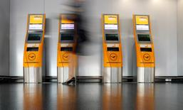 Lufthansa Check-in machines are pictured in Frankfurt airport, Germany, March 17, 2016. Picture taken with a long exposure.  REUTERS/Kai Pfaffenbach/File Photo