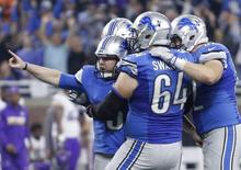 Nov 24, 2016; Detroit, MI, USA; Detroit Lions kicker Matt Prater (5) celebrates with center Travis Swanson (64) and teammates after kicking the game winning field goal as time expired in the fourth quarter against the Minnesota Vikings at Ford Field. Mandatory Credit: Raj Mehta-USA TODAY Sports