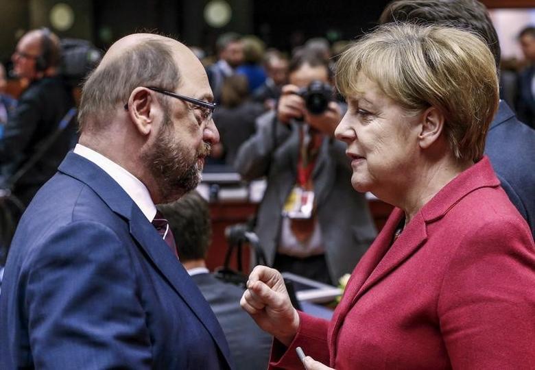 2016年3月17日,布鲁塞尔,欧洲议会议长舒尔茨和德国总理默克尔在欧盟领导人峰会上会面。REUTERS/Yves Herman