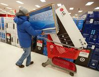 A customer loads his shopping cart at Target in Chicago. REUTERS/Kamil Krzaczynski