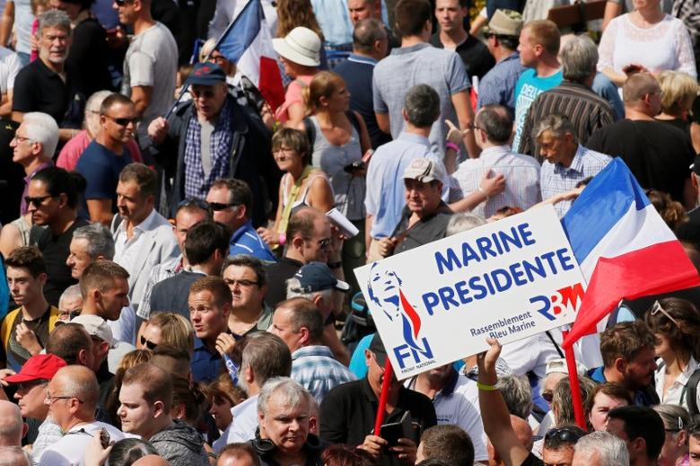 Supporters of Marine Le Pen, French National Front (FN) political party leader and Member of the European Parliament, attend a FN political rally in Brachay, France, September 3, 2016. REUTERS/Gonzalo Fuentes