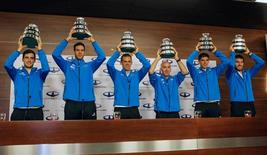 Members of the Argentina's Davis Cup tennis team hold up trophies after arriving in Buenos Aires, Argentina, November 29, 2016. REUTERS/Agustin Marcarian