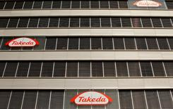 Logos of Japanese Takeda Pharmaceutical Co are seen at an office building in Glattbrugg near Zurich March 7, 2012.   REUTERS/Arnd Wiegmann/File Photo