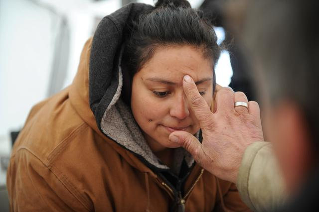 A woman receives a natural ointment in the Oceti Sakowin camp during a protest against plans to pass the Dakota Access pipeline near the Standing Rock Indian Reservation, near Cannon Ball, North Dakota, U.S. November 30, 2016. REUTERS/Stephanie Keith