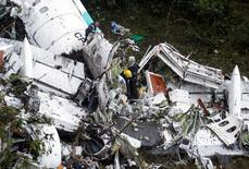 Rescue crews work in the wreckage from a plane that crashed into Colombian jungle with Brazilian soccer team Chapecoense onboard near Medellin, Colombia, November 29, 2016. REUTERS/Fredy Builes