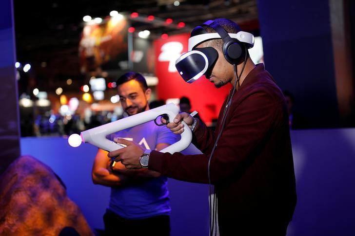 A man plays Farpoint on a Sony PlayStation VR at the Paris Games Week, a trade fair for video games in Paris, France, October 26, 2016. REUTERS/Benoit Tessier