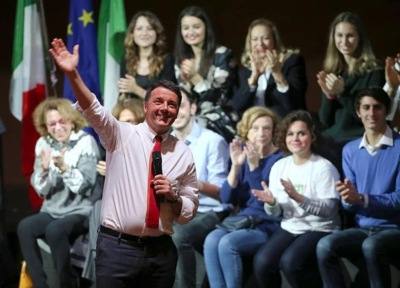 Italian Prime Minister Matteo Renzi waves as he talks during a meeting in support of the 'Yes' vote in the upcoming constitutional reform referendum in Rome, Italy November 26, 2016. REUTERS/Alessandro Bianchi