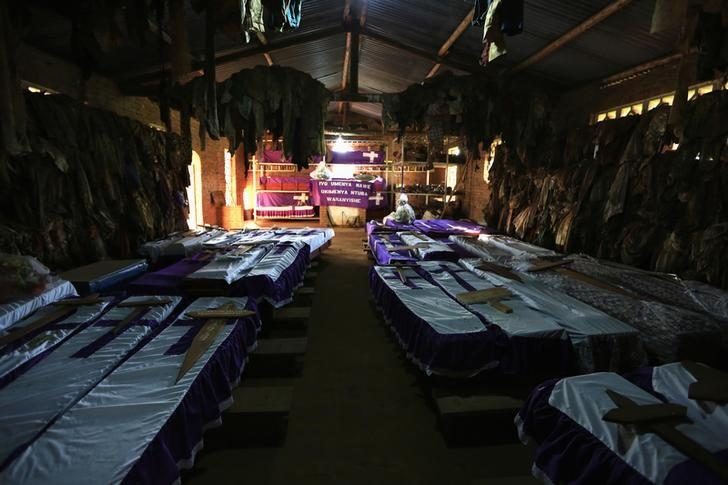 Coffins containing the remains of victims of mass killings during the 1994 genocide are displayed in a Catholic Church in Nyamata April 9, 2014. REUTERS/Noor Khamis/Files