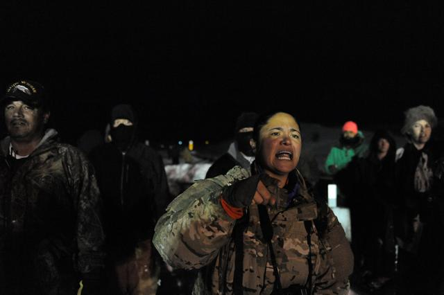 Veterans have a confrontation with police on Backwater bridge during a protest against plans to pass the Dakota Access pipeline near the Standing Rock Indian Reservation, near Cannon Ball, North Dakota, U.S., December 1, 2016. REUTERS/Stephanie Keith