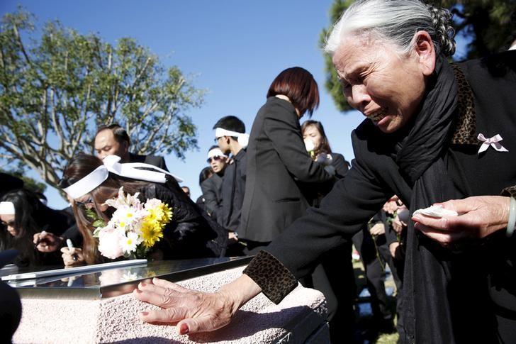 A family member cries during the funeral for a San Bernardino shooting victim at Good Shepherd Cemetery in Huntington Beach, California, December 12, 2015. REUTERS/Patrick T. Fallon/Files