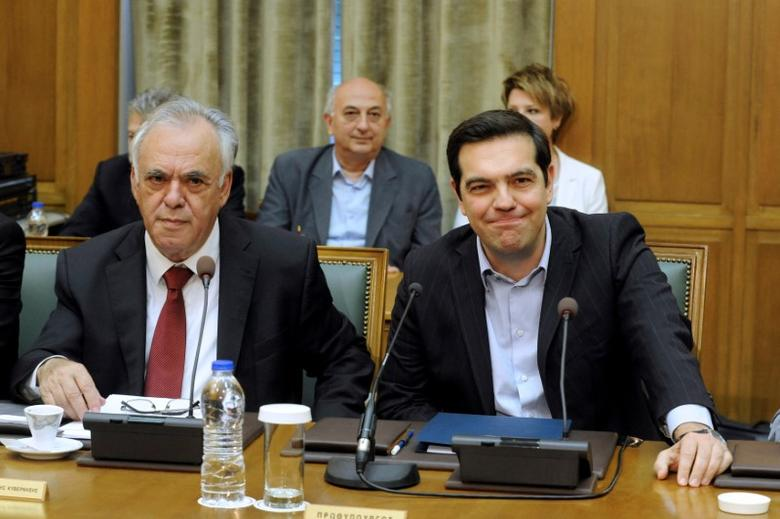 Greek Prime Minister Alexis Tsipras (R) and Deputy Prime Minister Yannis Dragasakis attend the meeting of the cabinet in the parliament building in Athens, Greece, May 10, 2016. REUTERS/Michalis Karagiannis