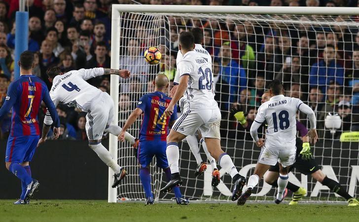 Football Soccer - Barcelona v Real Madrid - Spanish La Liga Santander- Nou Camp Stadium, Barcelona, Spain - 3/12/16. Real Madrid's Sergio Ramos scores a goal during the ''Clasico''.    REUTERS/Albert Gea