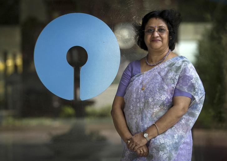 Arundhati Bhattacharya, Chairman of the State Bank of India, poses with the company's logo at the bank's headquarters in Mumbai March 24, 2015. REUTERS/Danish Siddiqui/File Photo