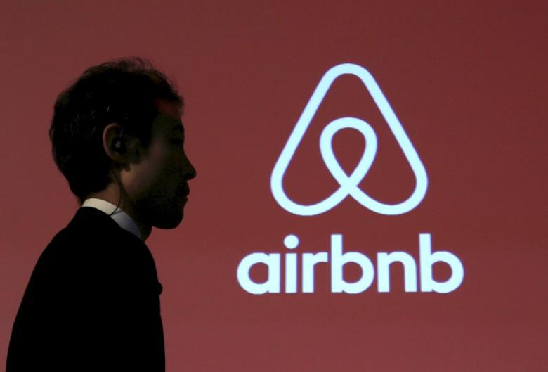 A man walks past a logo of Airbnb after a news conference in Tokyo, Japan, November 26, 2015. REUTERS/Yuya Shino/File Photo