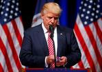 Republican U.S. Presidential nominee Donald Trump holds a Purple Heart given to him during a campaign event at Briar Woods High School in Ashburn, Virginia, U.S., August 2, 2016. REUTERS/Eric Thayer/Files
