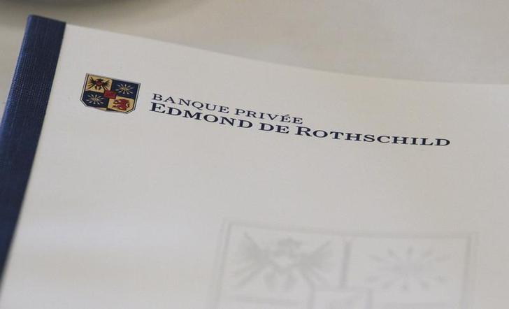 A logo of Banque Privee Edmond de Rothschild is seen on a document during a news conference for the group's 2010 results, in Geneva March 31, 2011.  REUTERS/Denis Balibouse/Files
