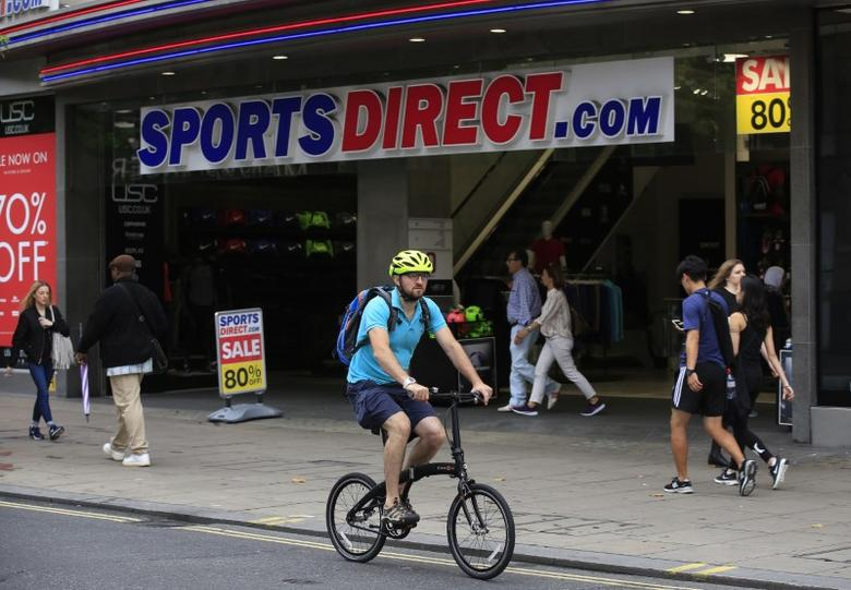 A man cycles past a Sports Direct store on Oxford Street in London July 22, 2016.     REUTERS/Paul Hackett