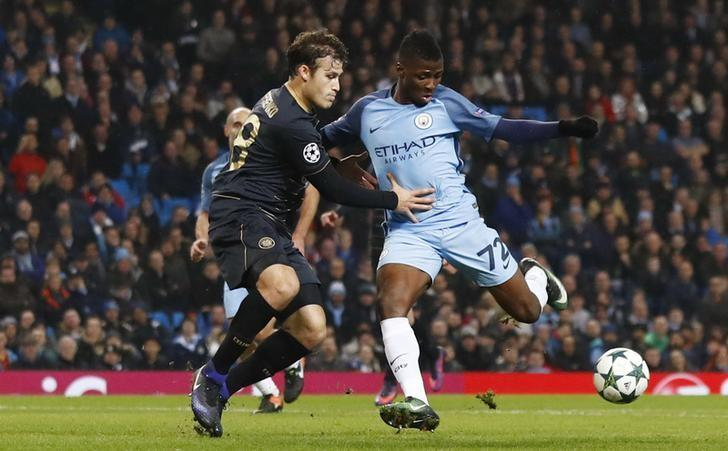 Britain Football Soccer - Manchester City v Celtic - UEFA Champions League Group Stage - Group C - Etihad Stadium, Manchester, England - 6/12/16 Manchester City's Kelechi Iheanacho in action with Celtic's Erik Sviatchenko  Action Images via Reuters / Jason Cairnduff Livepic