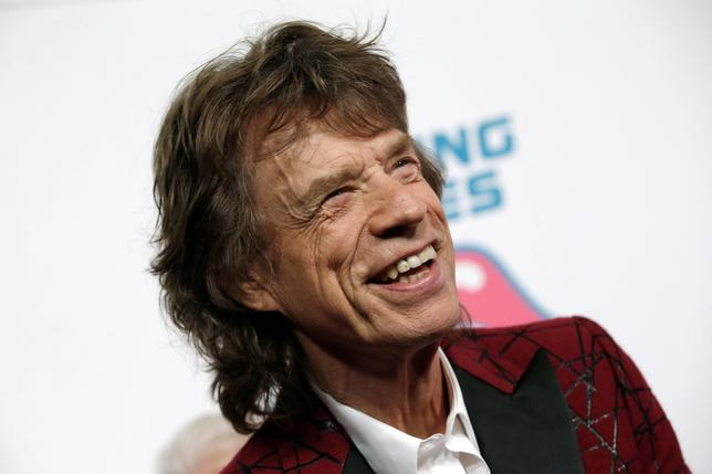 Mick Jagger of The Rolling Stones poses for photographers as the band arrives for the opening of the new exhibit ''Exhibitionism: The Rolling Stones'' in the Manhattan borough of New York City, U.S., November 15, 2016.  REUTERS/Mike Segar/File Photo