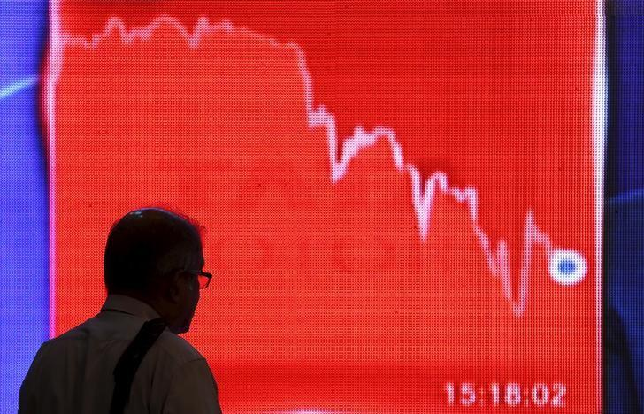A man looks at a screen displaying news of markets update inside the Bombay Stock Exchange (BSE) building in Mumbai, India, February 11, 2016. REUTERS/Danish Siddiqui/Files