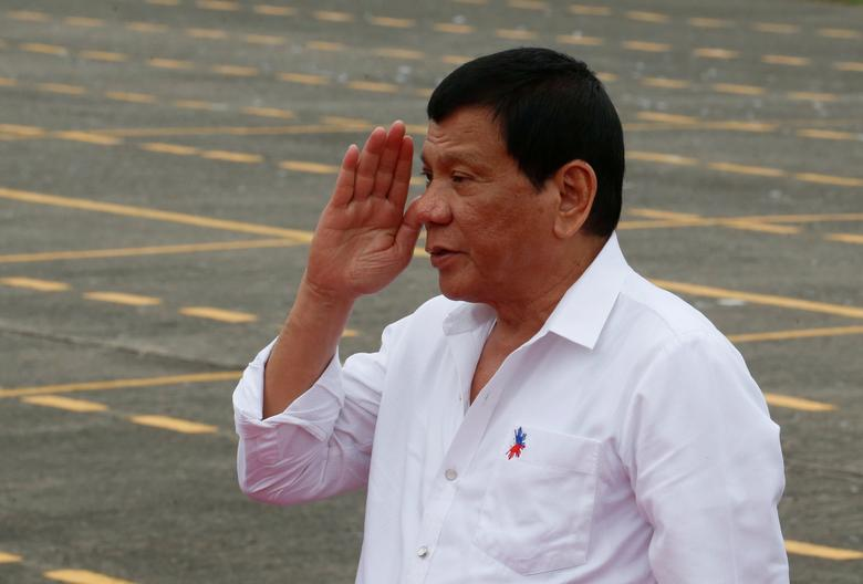 Philippine President Rodrigo Duterte salutes as he arrives to take part during the change of command for the new Armed Forces chief at a military camp  in Quezon city, Metro Manila, December 7, 2016. REUTERS/Erik De Castro