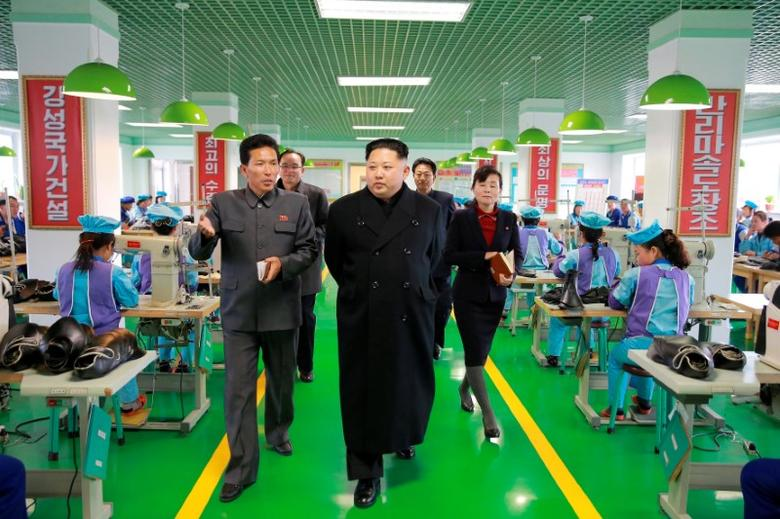 North Korean leader Kim Jong Un visits the Wonsan Shoe Factory in this undated photo released by North Korea's Korean Central News Agency (KCNA) in Pyongyang December 9, 2016. KCNA via REUTERS