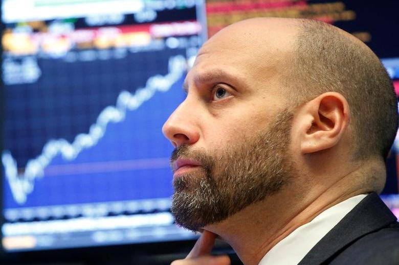 Specialist Meric Greenbaum works at his post on the floor of the New York Stock Exchange (NYSE) in New York City, U.S., December 9, 2016. REUTERS/Brendan McDermid