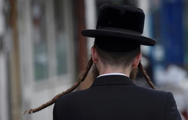 An orthodox Jewish man walks through a street in Stamford Hill north London, Britain May 3, 2016. REUTERS/Hannah McKay